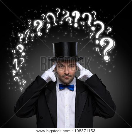 thinking magician surrounded by question marks