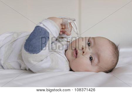 Baby Boy Lying On Back