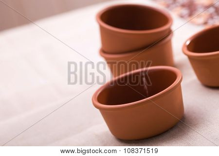 Four Clay Dishes