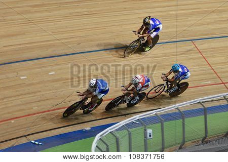 ST. PETERSBURG, RUSSIA - AUGUST 11, 2015: Unidentified riders compete in team race during Russian track cycling championship. Velodrome Lokosphinx hosts the competitions