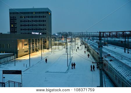 TYUMEN, RUSSIA - JANUARY 6, 2015: People on the platform of train station in a winter evening. Found in 1586, Tyumen is the first Russian city in Siberia
