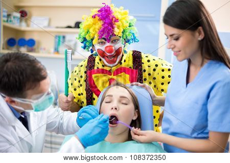 Colorful clown teach - who don't use toothbrush ends in dental clinic
