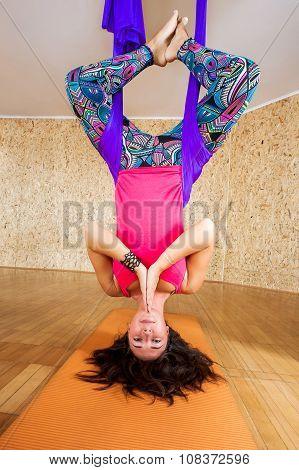Woman doing antigravity Aerial yoga