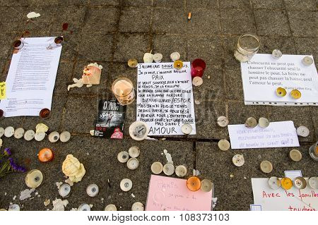 Messages, Candles And Flowers In Memorial For The Victims