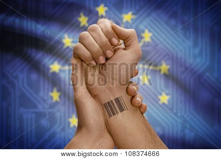 Barcode Id Number On Wrist Of Dark Skinned Person And Usa States Flags On Background - Indiana