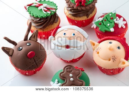 Colorful decorative Christmas cupcakes  with candy elements on top