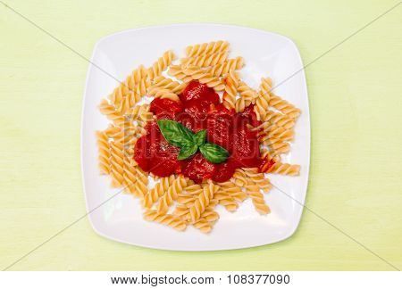 Fusilli with tomato sauce on green top