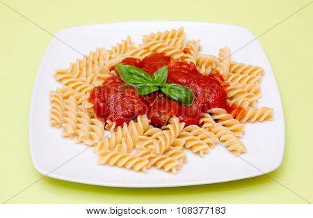 Fusilli with tomato sauce on green