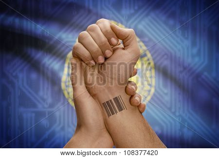Barcode Id Number On Wrist Of Dark Skinned Person And Usa States Flags On Background - Nebraska