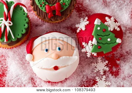 festive Christmas mini desserts over snowy background