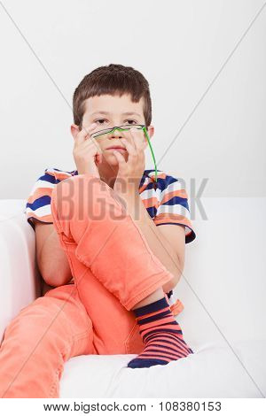 Portrait Of Serious Kid Little Boy.