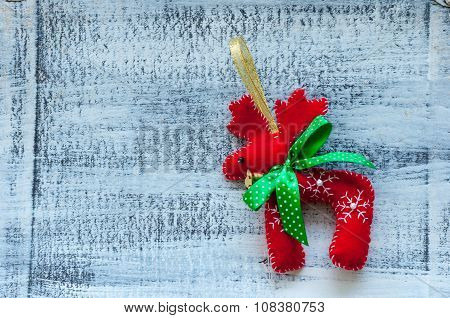 Red christmas deer with green bow on white background