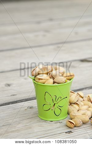 Pistachio Nuts On A Wooden Surface