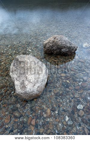 Closeup Of Boulders In Shallow Water.