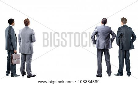 four business mans from the back - looking at something over a white background