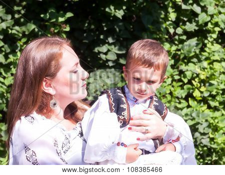 Romanian Woman Peasant Hugging Her Baby Boy