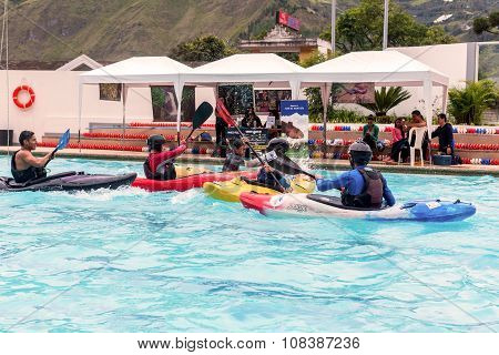 Banos Ecuador - 23 May, 2015: Unidentified Ecuadorian Sports Guides Competes At The Canoeing Contest In A Swimming Pool In Banos De Agua Santa On May 23,  2015