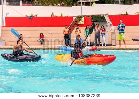 Banos Ecuador - 23 May, 2015: Unidentified Hispanic Team Competes At The Canoeing Contest In A Swimming Pool In Banos On May 23, 2015