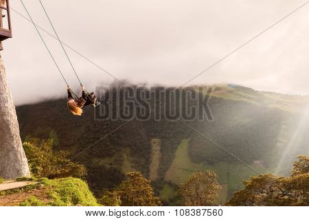 Silhouette Of Young Happy Blonde Woman On A Swing