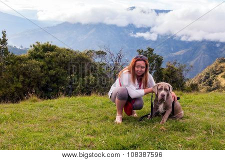 Young Blonde Playing With Neapolitan Mastiff Puppy Outdoor
