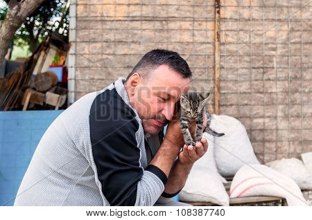 Dark Haired Man With Mustache And Atoady Kitten