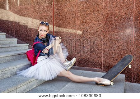 Ballerina Hipster Sits On The Steps.