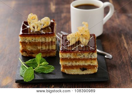 portioned dessert piece of cake with cream and chocolate on a plate