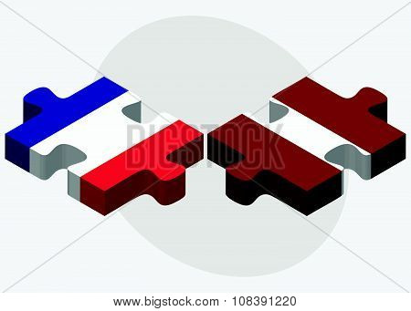 France And Latvia Flags