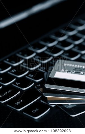 Credit cards on the laptop keyboard