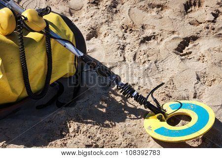 metal detector on the sandy beach