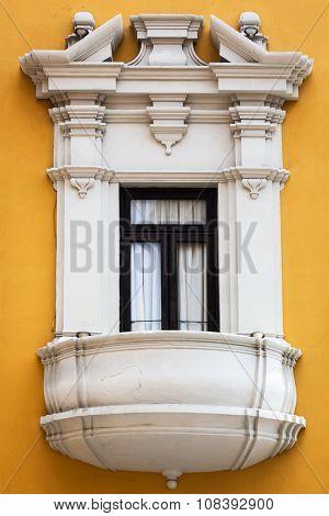 beautiful balcony window and yellow wall