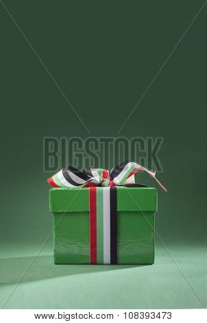 UAE National Day - Small gift box tied with ribbon with UAE national colors.