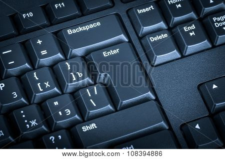 Electronic Collection - Black Computer Keyboard. The Focus On The Enter Key. Toning Is Blue.