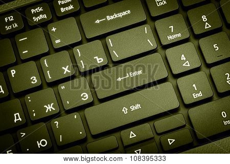 Electronic Collection - Laptop Keyboard. The Focus On The Enter Key. Toning Is Green.
