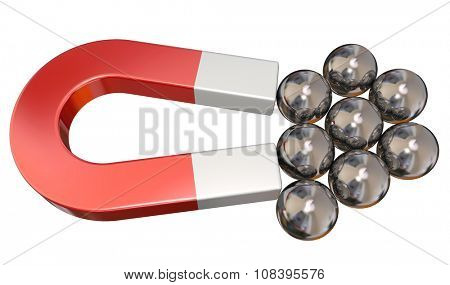 Reg metal magnet attracting several ball bearings to illustrate magnetic pull or force