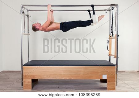 Pilates aerobic instructor man in fitness exercise