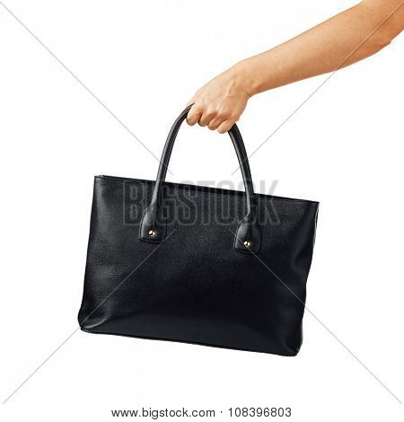 hand holding women's leather handbag, isolated on white