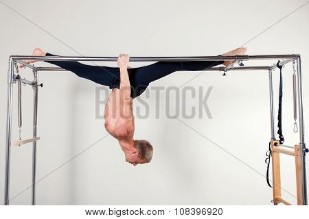 Pilates aerobic instructor man in fitness exercise acrobatic upside down balance