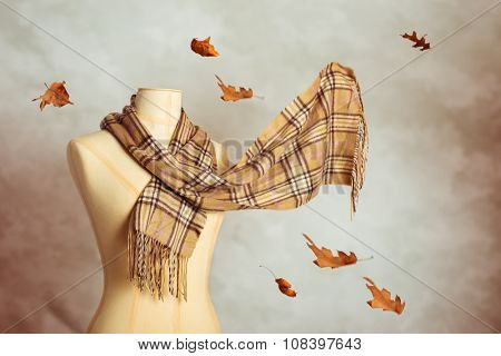 Vintage tailors dummy with woollen autumn scarf - blur in scarf to give motion effect