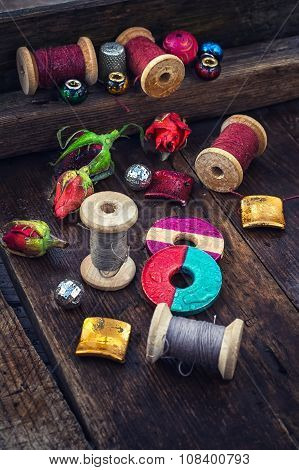 Bright beads and thread for needlework