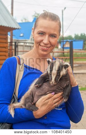 Young attractive woman with badger