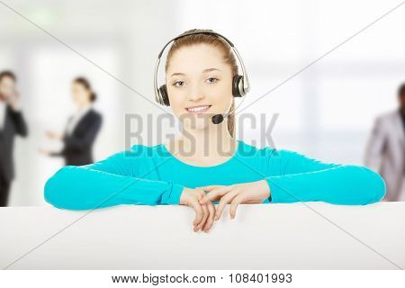 Young call center woman with billboard.