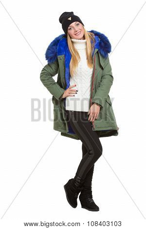 woman wearing winter jacket scarf and cap