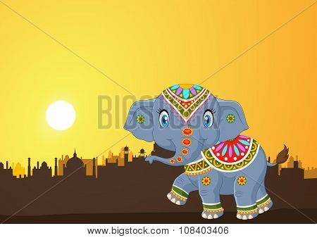 Cute elephant mascot wearing traditional costume on the sunset background