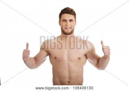 Handsome muscular man showing ok sign.