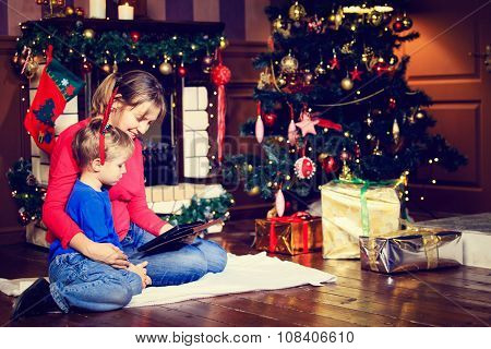 mother and son looking at touch pad on Christmas