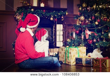 father and son looking at fireplace on Christmas