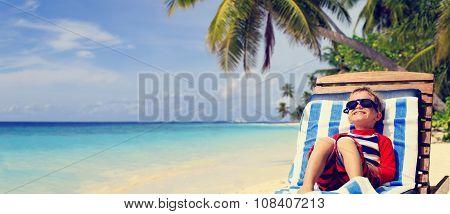 little boy relaxed on summer tropical beach
