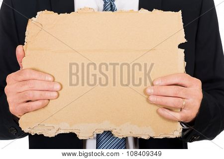 Male hand with a piece of cardboard
