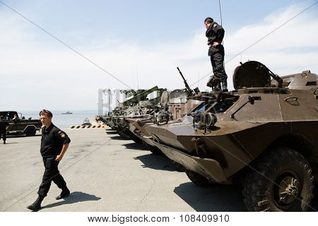 VLADIVOSTOK, RUSSIA - JULY 22, 2015: Armored vehicles and army soldiers Russia on the waterfront in Vladivostok to celebrate the holiday the Day of the Navy